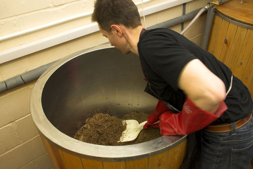 Ascot Ales digging the spent grain out of the Mash Tun